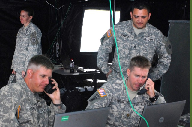 SCHOFIELD BARRACKS, Hawaii - U.S. Army, Pacific Contingency Command Post Deployment Assessment Team personnel coordinate remote assessments of missions during Exercise Makani Pahili 2010. Clockwise from right are Sgt. 1st Class Andy Murdock, DAT operations non-commissioned officer, Maj. Kevin Stonerook, DAT operations officer, Maj. Keegan Leonard, DAT deputy chief of operations, and Sgt. Dominique Ambrose, DAT Information Management Operations.