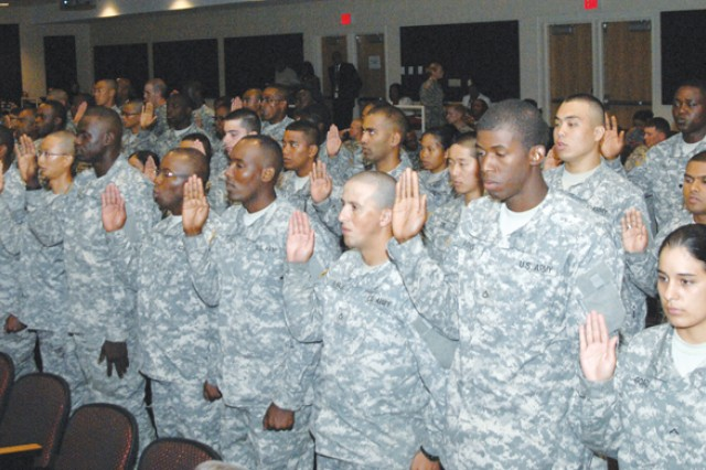 Soldiers take the oath of citizenship Tuesday.