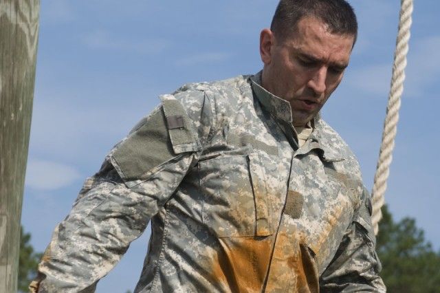 FORT BRAGG, N.C. - Showing his endurance, Spc. Colin O'Neil, a Soldier with the 443rd Civil Affairs Battalion out of Warwick, R.I., finishes his last obstacle here on June 15, as part of this year's U.S. Army Civil Affairs and Psychological Operations (Airborne) Best Warrior competition. O'Neil and 13 other Soldiers and noncommissioned officers from across the nation are competing to take home this year's Best Warrior of the Year Soldier, or NCO category. The 443rd CA Battalion is a subordinate unit under the 353rd Civil Affairs Command, which is under USACAPOC(A). The overall command is comprised of nearly 12,000 Soldiers in 67 units across 31 states and Puerto Rico. USACAPOC(A) is five percent of the U.S. Army Reserve Command's force and is responsible for approximately 20 percent of the Army Reserve deployments.