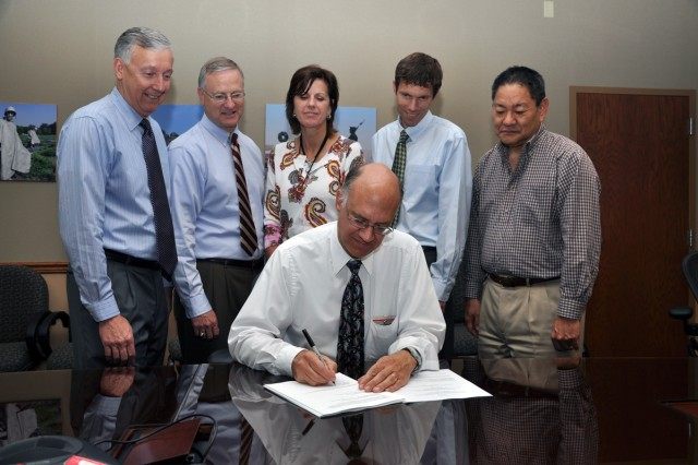 Ron Dillon, contracting officer at USAMSDC/ARSTRAT, signs the Long Endurance Multi-Intelligence Vehicles (LEMV) agreement with Northrop Grumman. The agreement provides for the design, development and testing of a long-duration hybrid airship system within an 18-month time period, and then transport of the asset to Afghanistan for military assessment.