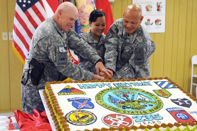 Command Sgt. Maj. Sal Katz, Pvt. Sepe Salik, and Sgt. Maj. Danilo Diaz cut an Army birthday cake during a ceremony, June 14, at Camp Liberty, Iraq. The event was in recognition of the Army's 235th birthday. Diaz and Salik served as the oldest and youngest Soldiers during the cake cutting.