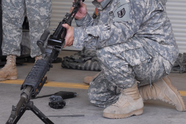 "FORT HOOD, Texas - Pfc. Andre Figueroa, a native of Tacoma, Wash. and supply specialist for Headquarters and Headquarters Battery, 41st Fires Brigade, assembles a machine gun during the brigade's ""Best by Test"" competition, here ,June 14."
