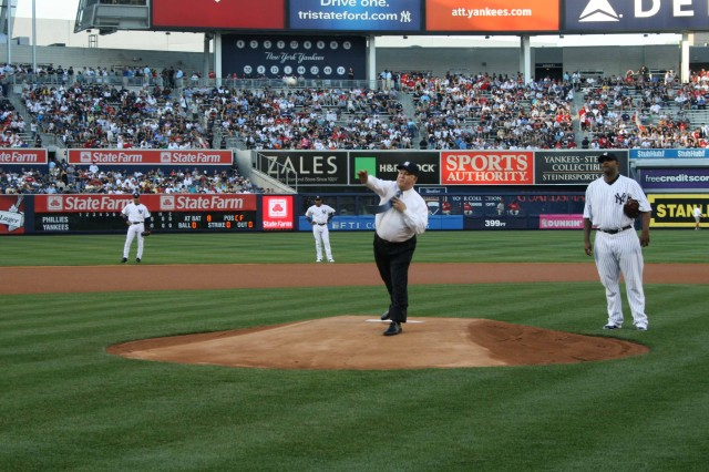 The Under Secretary of the Army, Dr. Joseph Westhphal, throws out the first pitch while Derek Jeter, Robinson Cano and CC Sabathia look on during the New York Yankees June 15 home game that celebrated the US Army's 235th Birthday.