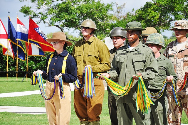 Soldiers dressed in period uniforms present battle streamers to be attached to the Army flag. Sgt. Maj. Shawn Barnes, U.S. Army Garrison, attached the 178 streamers, which represent 235 years of the Army's service to our nation.