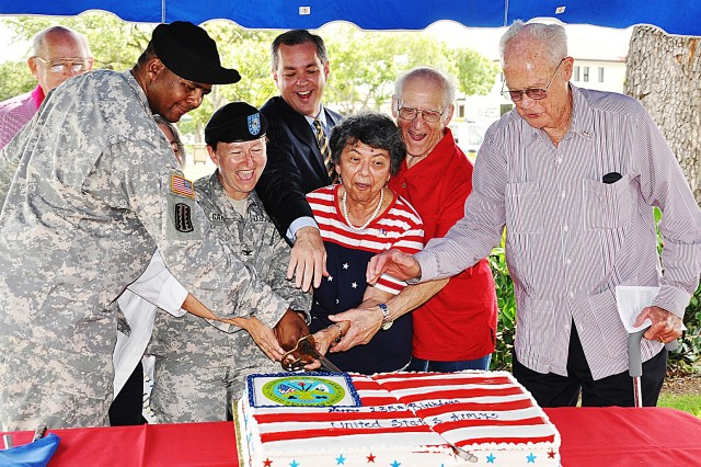 Command Sgt. Maj. James Diggs, Col. Mary Garr, Councilman John Clamp, Minerva and Hans Nadler and Louis Stumberg, civilian aide emeritus to the secretary of the Army, cut the cake at the Army Birthday celebration June 14. Nadler's Bakery donated the cake for the event.