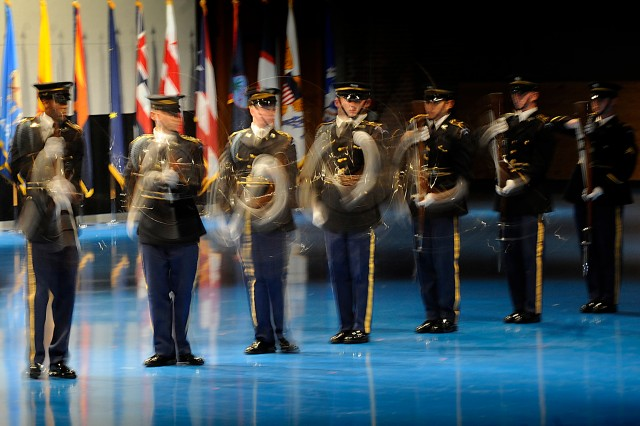 The U.S. Army Drill Team, with 3rd U.S. Infantry Regiment (The Old Guard), performs during a Twilight Tattoo ceremony in celebration of the U.S. Army's 235th birthday at Fort Myer, Va., June 16, 2010.  The Old Guard's motto is Noli Me Tangere (from Latin: - Touch me Not).