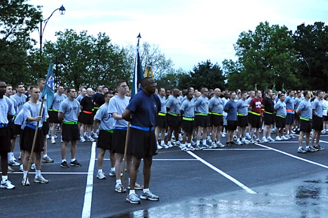 """The mass formation before the Army Birthday fun run included active duty members, family members and civilians June 14 in the Bell Hall parking lot. The run was part of the 235th Army birthday celebration that also featured a cake cutting and Soldiers reading essays they wrote titled """"Why I am proud to be an American Soldier."""""""