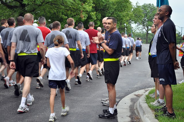 Combined Arms Center Command Sgt. Maj. Philip Johndrow and Command and General Staff College Deputy Commandant Maj. Gen. Edward Cardon congratulate and cheer on runners as they finish the Army birthday fun run June 14 in the Bell Hall parking lot. Johndrow and Cardon are accompanied by Fort Leavenworth Soldier and Noncommissioned Officers of the Year Sgt. Lisa Sizemore of Medical Department Activity; Staff Sgt. John Hoover of Headquarters and Headquarters Company, CAC, Special Troops Battalion; and Spc. Kelvin Smith of MEDDAC.
