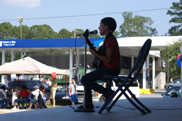 Isabelle Lopez-Guerrero, 10, performs at the CYSS celebration of the Army's 235th birthday. Isabelle won first place in the Military Teen Idol Competition, June 12.