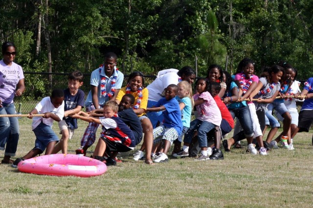 Children of various ages from Hunter's Child and Youth Services play tug-of-war in the 100 degree heat to celebrate the Army's 235th birthday, June 14. Children, staff and volunteers enjoyed several games and activities set up behind Hunter's new Youth Center.