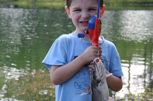 Hunter Vanderpool, 4, proudly shows off a catfish he's just landed during the Kids Fishing Rodeo held at Fort Stewart's Pond #30, June 12.