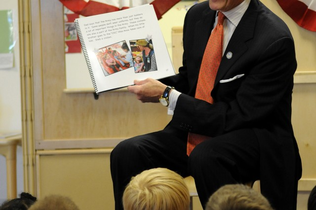 """Secretary of the Army John McHugh reads passages from the book """"Happy Birthday U.S. Army"""" to students at the Cody Child Development Center at Joint Base Myer-Henderson Hall, Va."""