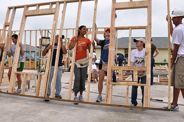 Teamwork was key in getting the different sections of the wall frames into place.