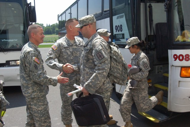 LATHAM,NY--New York Army National Guard Chief of Staff Col. James Lettko, greets returning members of the 206th Military Police Company Friday, June 16, as the main body gets off the bus at New York State Division of Military and Naval Affairs Headquarters here. Brig. Gen. Patrick Murphy, the Adjutant General of New York (in background), Lettko, and Brig. Gen. Michael Swezey, the commander of the 53rd Troop Command, greeted the MPs as they returned to their families after 10 months in Iraq.  More than 160 Soldiers deployed with the company and reunions also occured in the Hudson Valley, Utica, Auburn, Rochester and Buffalo.