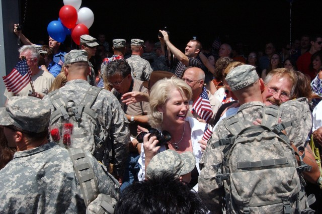 LATHAM--Members of the New York Army National Guard's 206th Military Police Company wade into a crowd of well-wishers as they return to home station at New York State Division of Military and Naval Affairs headquarters on Friday, June 18.   More than 70 members of the unit from New York's Capital Region returned to company headquarters here. More than 160 National Guard Soldiers deployed to Iraq with the company and similar receptions occured a Camp Smith near Peekskill, Utica, Rochester, Buffalo and Auburn on Friday.