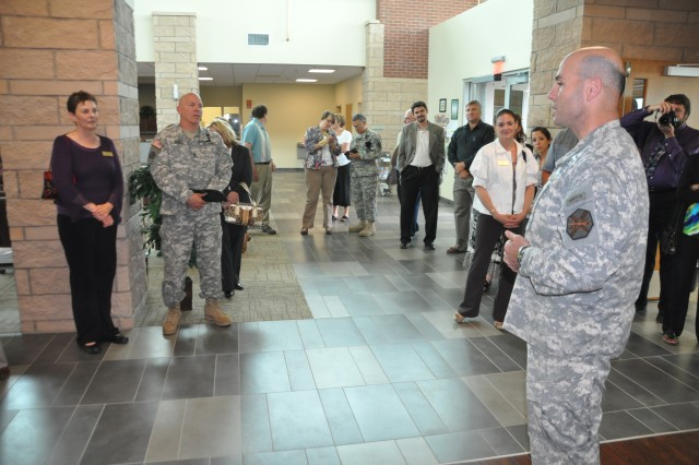FORT CARSON, Colo.--- Col. Robert F. McLaughlin, garrison commander, speaks to staff and community partners at the Soldier and Family Assistance Center open house held June 3.