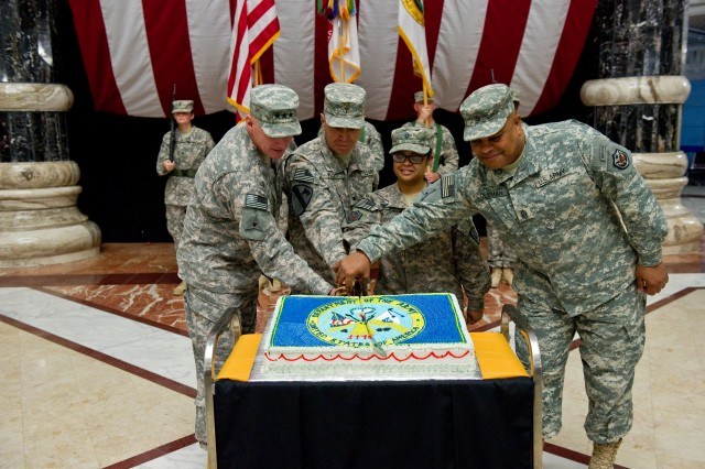 From left, Lt. Gen. Bob Cone, deputy commanding general for operations, United States Forces-Iraq, and III Corps commander, Chaplain (Col.) William D. Willett, senior Catholic priest for USF-I, Spc. Jessica Randon from Armed Forces Radio Network-Iraq, and Command Sgt. Maj. Arthur L. Coleman Jr., Cone's senior enlisted advisor, make the ceremonial cut of the cake during the U.S. Army's 235th birthday celebration at Al Faw Palace on Camp Victory, Iraq, June 14. Willett is the oldest Soldier in USF-I and Randon is the youngest.