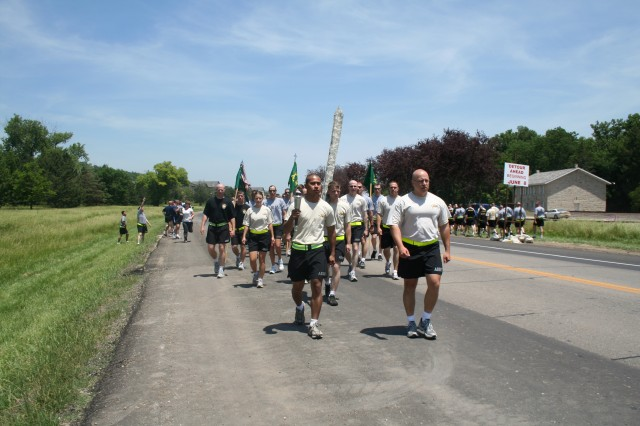Members of the 97th MP Bn., begin the second leg of the Special Olympics Law Enforcement Torch Run June 4 near the First Territorial Capitol at Fort Riley.