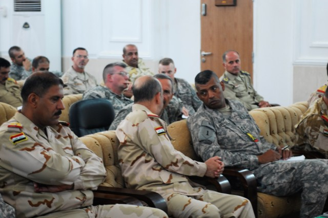 Lt. Gen. Muhammad Jawad Hawaydi (left), Basra Operations Center commander, and Maj. Gen. Vincent Brooks (right), 1st Infantry Division and United States Division-South commanding general, discuss key points made during the Southern Borders Conference held at the BaOC June 14, 2010.