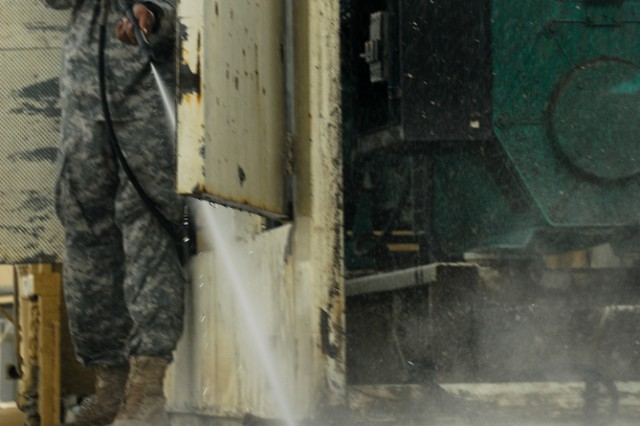 Spc. Jonathan Mercedes, Headquarters and Headquarters Battery, 17th Fires Brigade, supply clerk and native of New York, pressure washes a generator while preparing it for turn in as the 17th Fires Bde. prepares for redeployment.
