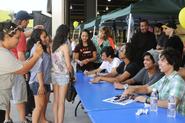 Fort Riley fans line up for autographs from Allstar Weekend, following the band's performance at the Victory Week festival and concert June 18 on Marshall Army Airfield.