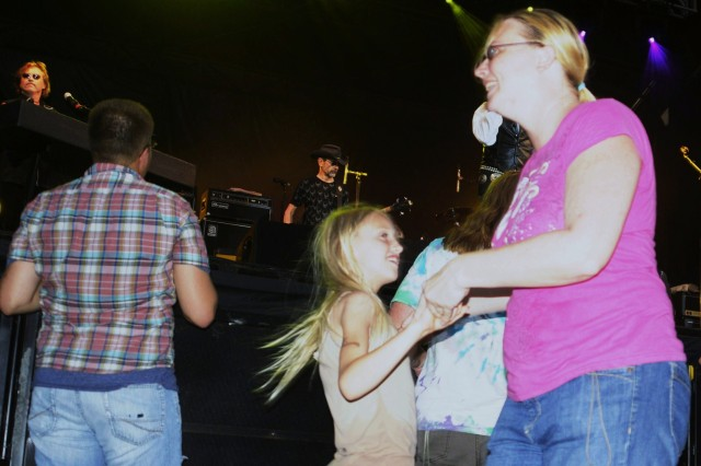 Fans dance in front of the stage while Grand Funk Railroad performs during the Victory Week festival and concert June 18 on Marshall Army Airfield, Fort Riley.