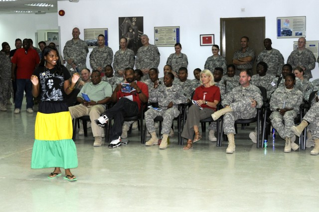 Suzette Owens, the digital master gunner for the Army Battle Command Systems for the TF Marne G-6 and a Jamaican native, interacts with the crowd as the host of the Caribbean-American Heritage Month celebration at the Task Force Marne headquarters, June 18. Soldiers from various Caribbean islands gave histories of the islands and performed songs and dances.