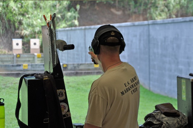 FORT BENNING, Ga. -- Staff Sgt. Timothy Barber, U.S. Army Marksmanship Unit, fires during the service pistol team match June 17 at Phillips Range, the site of the 51st Interservice Pistol Championship. Barber and his USAMU teammates on U.S. Army Grey won the match, edging out their USAMU counterparts on U.S. Army Blue. Barber also won the centerfire individual championship. (Photo by Michael Molinaro, USAMU PAO)