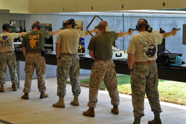 Soldiers, Marines, Airmen and Sailors compete June 15 in the 51st Interservice Pistol Championship, held on Fort Benning, Ga. The U.S. Army Marksmanship Unit carried the Army to victory as U.S. Army Blue won the team title and Staff Sgt. Robert Park won his first overall individual championship.