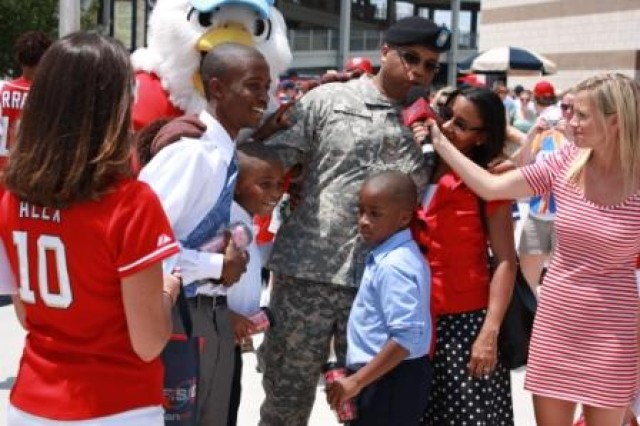 Maj. Sheldon Smith, 143rd Expeditionary Sustainment Command, his wife, Lolita, and their sons Cody, Jesse and Dakota, are recognized by the Washington Nationals baseball team during the Fathers Day Military Appreciation game June 20, 2010.