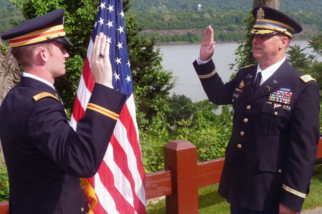 Col. Mark Armstrong Sr. administers the military oath of office to his son, 2nd Lt. Mark Armstrong Jr., at West Point May 22 as Armstrong Jr. becomes the fifth generation of his family that has graduated from the United States Military Academy. His father, a 1981 graduate of West Point, serves on active duty as the U.S. Army North Region IX Defense Coordinating Officer in Oakland, Calif.