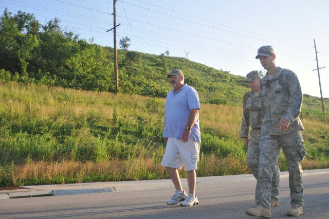 Gary Smith, father of fallen Senior Airmen Bradley Smith, marches with Air Force Staff Sgt. Larry Hickey and Air Force Lt. Col. Roy Fatur, 10th Air Support Operations Squadron, June 17 during a memorial ruck march in Brad Smith's honor. Gary Smith joined the Airmen, who marched for 470 miles, for the last leg of the march arriving at Fort Riley.