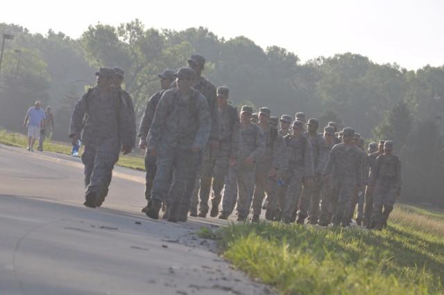 Airmen march in honor of fallen comrade