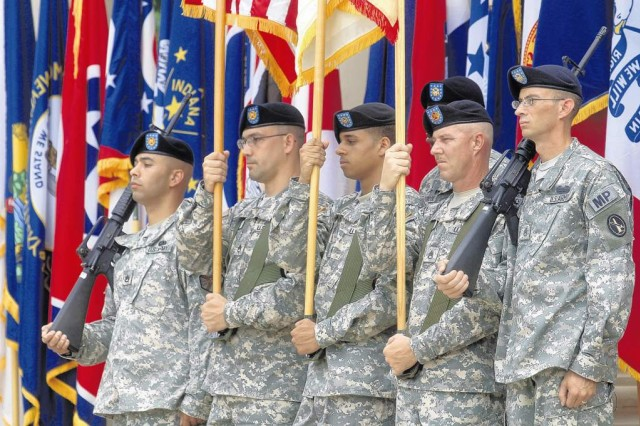 The Fort Belvoir Headquarters Battalion Color Guard holds steady as they participate in the 235th Army Birthday celebration.