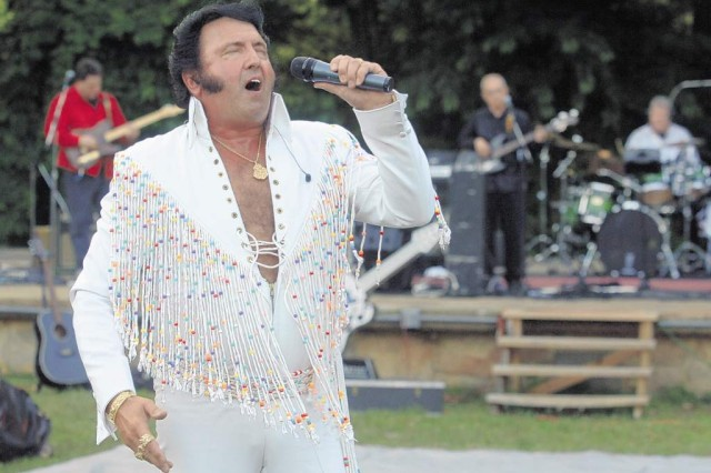 Lionel Ward performs as Elvis during the USO FMWR Movies on the Lawn series Friday.