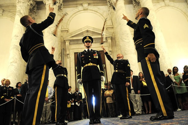 The 3rd U.S. Infantry's Army Drill Team performs a precision drill and rifle toss in celebration of the Army's 235th birthday Tuesday on Capitol Hill.