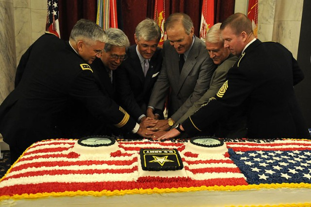 Left to right, Gen. George W. Casey, Army chief of staff, U.S. Senator Daniel Akaka (Hawaii), John McHugh, secretary of the Army, U.S. Rep.Chet Edwards (Texas), U.S. Rep. John Carter (Texas) and Sgt. Maj. Kenneth O. Preston, sergeant major of the Army, join together to cut the Army birthday cake June 15 at the Russell Senate Office Building on Capitol Hill.