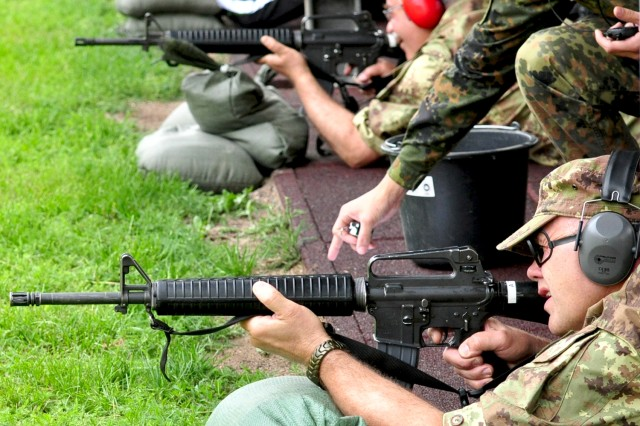 Italian Soldiers and other competitors fire M16s during the Monte Kali event in Wackernheim.