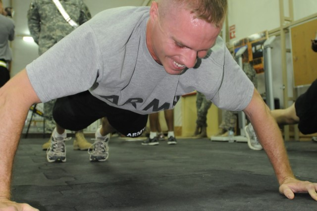Spc. Stephen Levins completes the push up portion of the Army Physical Fitness Test at Camp Buehring, Kuwait, June 14.  The APFT tests a Soldiers strength and endurance in three timed events: the push up, situp and two-mile run. (Photo by Sgt. Daniel Lucas, 203rd Public Affairs Detachment.)