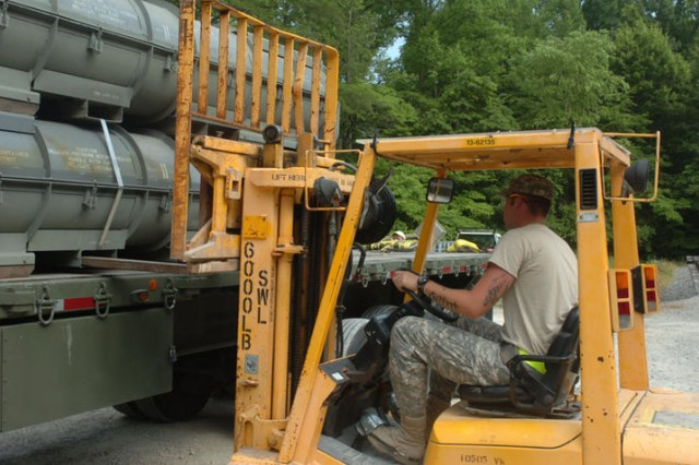 Sgt. Timothy Zuber, 221st Ordnance Company, operates a forklift to load ammunition onto a trailer during Operation Golden Cargo. Thousands of pounds of ordnance are loaded every day during OGC for movement to various Army ammo depots.