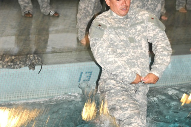 FORT SAM HOUSTON, Texas - Master Sgt. Noe Garcia, operations noncommissioned officer, U.S. Army North, jumps into the pool in his Army Combat Uniform, which he will use as a floatation device, during Water Survival Training at the Jimmy Brought Fitness Center indoor pool at Fort Sam Houston June 18. The techniques the Soldiers learned during the training are used as part of the Army's Water Survival Training Curriculum 21 - 21.