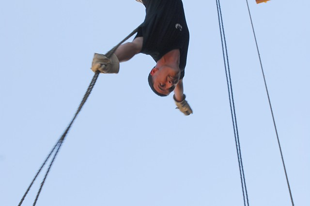 A Fort Bliss-based 978 Military Police Company noncommissioned officer, Sgt. Craig Walsh, demonstrates a rappel for 310th Military Police Battalion Soldiers from Uniondale, N.Y., after assisting in their training at Fort Bliss, Texas, June 18, 2010. The 310th Soldiers went through a nine-station obstacle course and rappelled the Fort Bliss tower as part of the Army Reserve 200th Military Police Command's Operation Guardian Justice.
