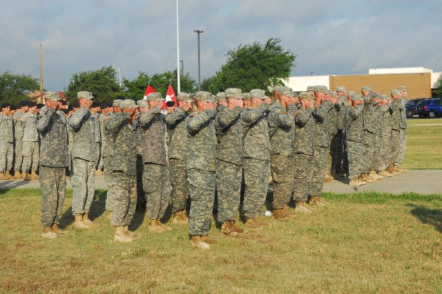 FORT HOOD, Texas- Recipients of the Expert Infantryman Badges salute together after a grueling 12 mile march, June 18. More than 270 Soldiers tested for the badge this time, but only 40 managed to earn it.