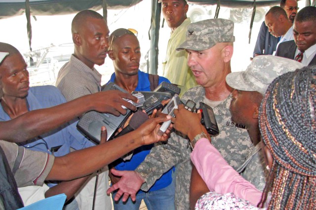 Louisiana Guardsman Col. Mike Borrell, commander of Task Force Kout Men, speaks to media in Haiti about plans for his unit. The 500-member task force will construct four new schools in the Gonaives area and conduct 10 medical readiness and training exercises, or MEDRETEs.