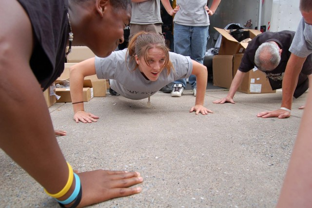 Future Soldier Paige Nye and fellow Future Soldiers, from the Mechanicsburg Army Recruiting Station, challenges community members to 30 pushups for a U.S. Army T-shirt June 17 at the 82nd Annual Jubilee Day in Mechanicsburg, Pa. Nye joined the Army last July and will be going to basic training June 30 at Fort Leonard Wood, Mo. Photo by Christine June, Harrisburg Recruiting Battalion.