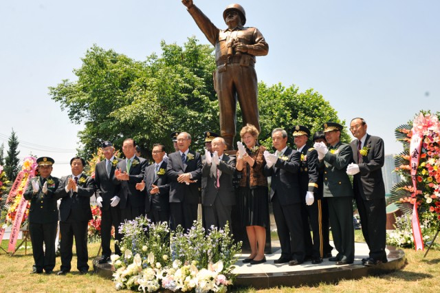 Senior Republic of Korea and U.S. government and military officials unveil the bronze statue honoring former 8th U.S. Army Commander Gen. Walton H. Walker, June 23, at a ceremony in front of the 8th U.S. Army headquarters in Seoul.