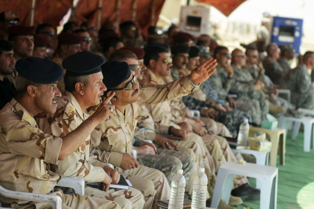 Iraq Army Soldiers watching exercise