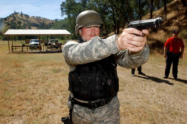 Spc. Clint W. Stork, an MP with the 330th Military Police Detachment, from Sheboygan, Wis., displays perfect form while conducting marksmanship training at a weapons firing range at Fort Hunter Liggett, Calif.