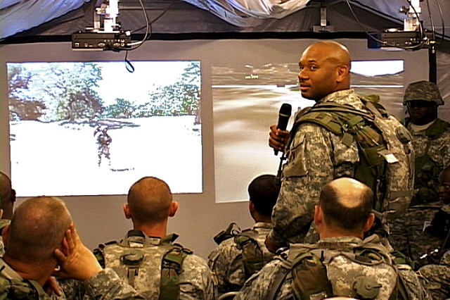 Soldiers of the 961st Transportation Detachment, Movement Control Team, Staten Island, N.Y., conduct an After Action Review using the data recorded by SRI International.  The AAR allows Soldiers to better understand their movements on the battlefield.