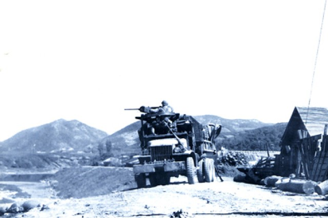 The cover of a brochure produced by the U.S. Army Center of Military History depicts troops of the 1st Cavalry Division in action against North Korean invaders, July 25, 1950.